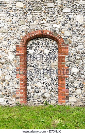 Stone Pillar Arch : Blocked up doorway brick pillars and arch with flint