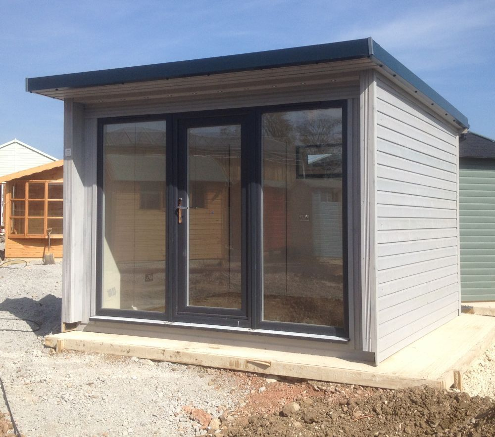 Doors and sidelights matching window on front and black onduline roof - Find This Pin And More On Sheds