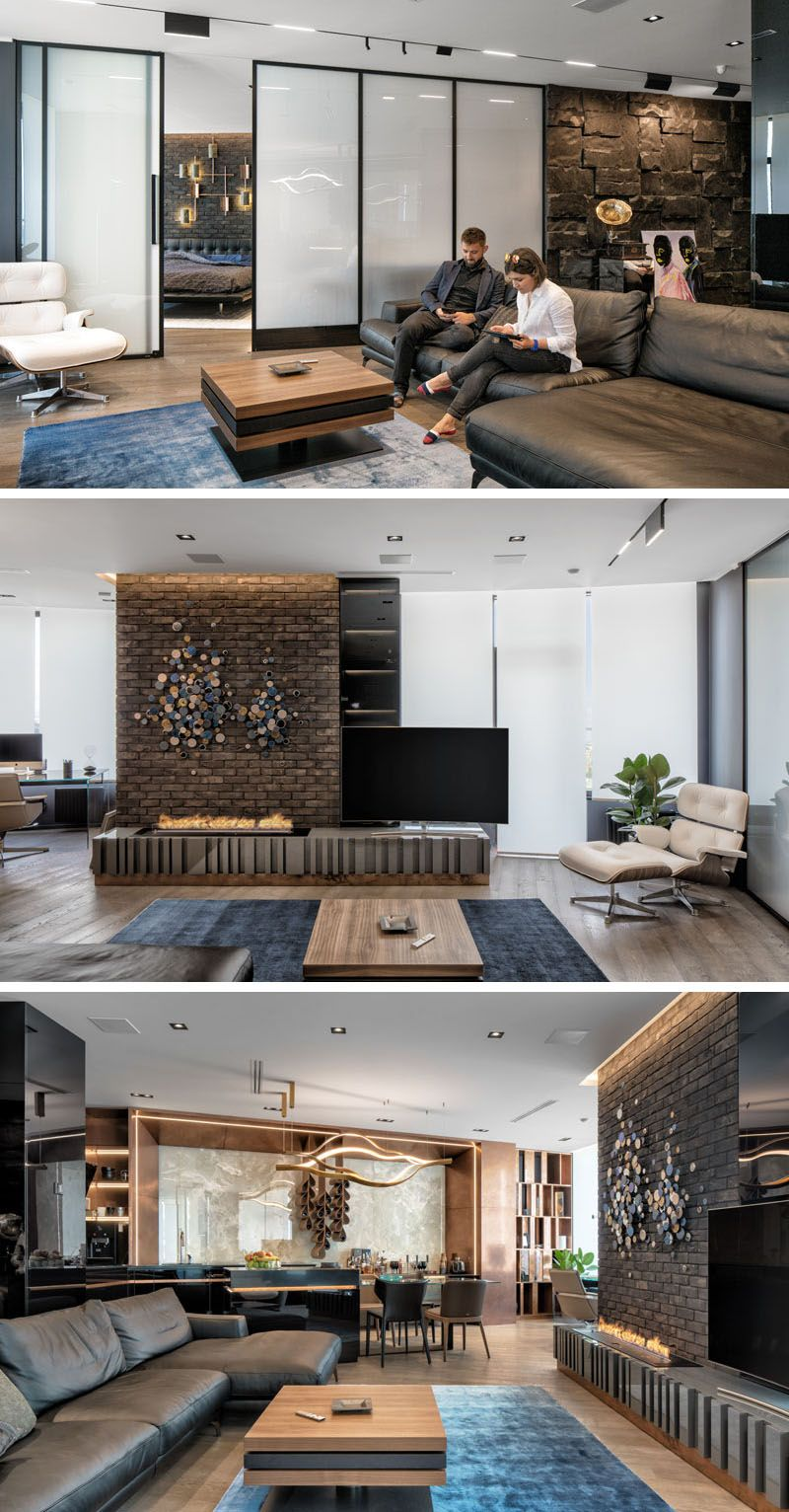 The dark interior palette of this modern apartment uses a variety of materials throughout its design such as brick natural african black stone onyx