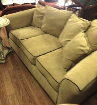 """Tuxedo sofa with loose back pillows. Durable and soft taupe-gray ultra suede with chocolate piping. 80"""" x 33"""" x 26"""" tall"""