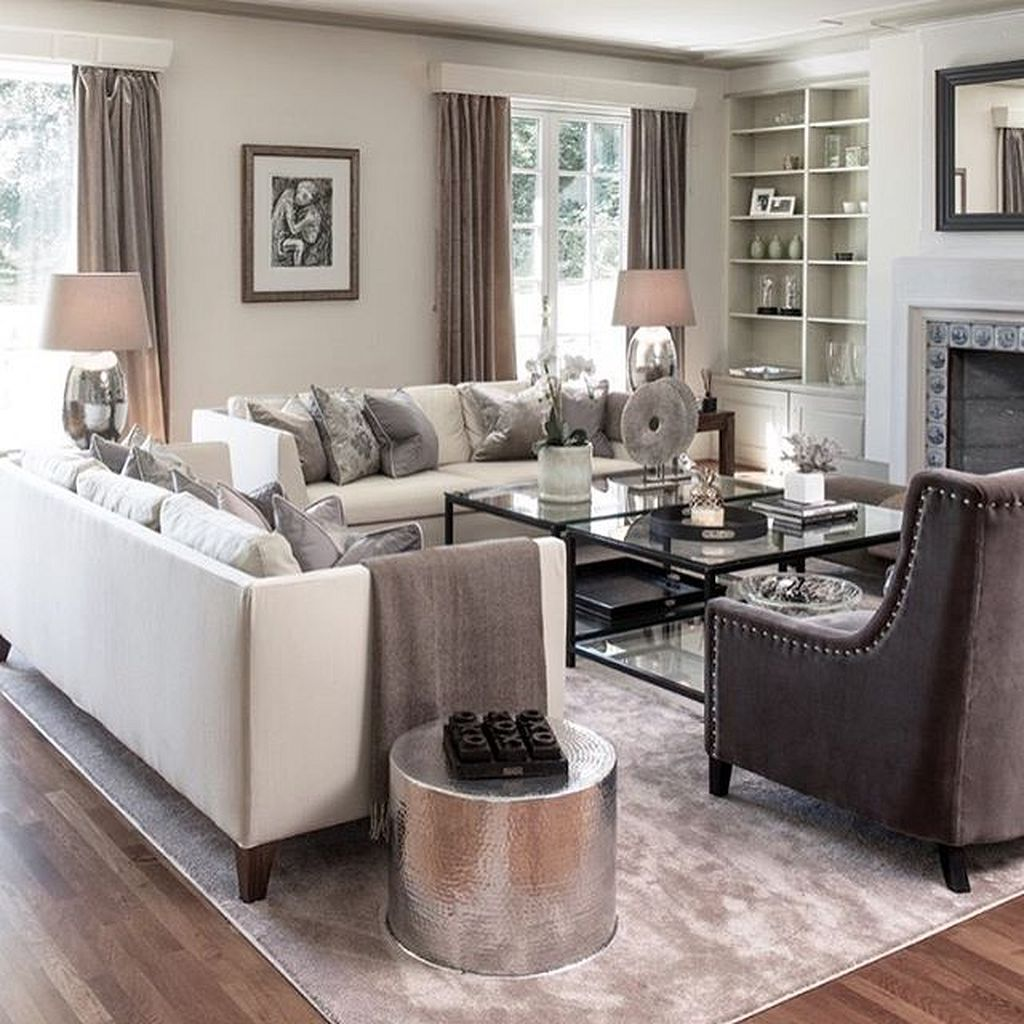 Classic Lines Keep This Plush Living Room Looking Clean And Organized. A  Masterful Mix Of Earth Tones Evokes Comfort, Relaxation, And Zen.