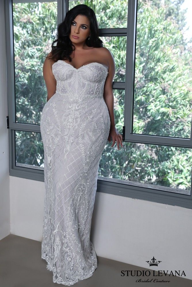 Plus size corset mermaid wedding gown with a stunning lace pattern ...
