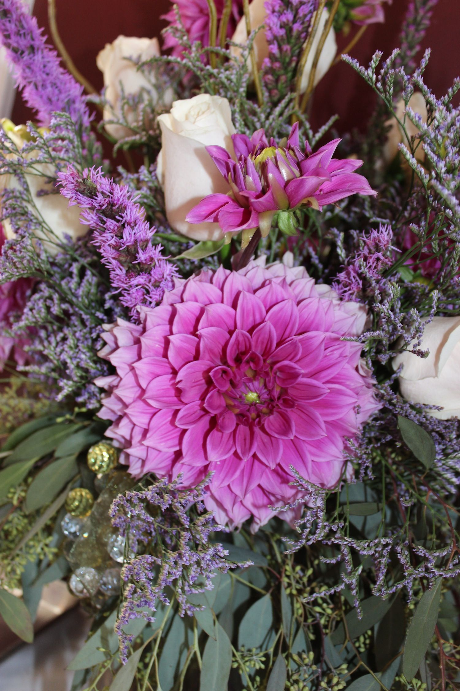 Lavender dinnerplate Dahlia surrounded by seeded