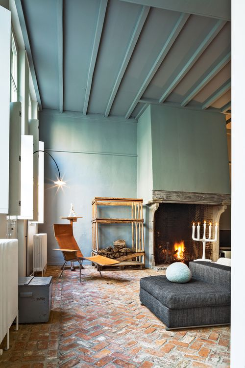 Elegant Herringbone Brick Flooring, Teal Walls, Grey And Wood Toned Furniture   U003e A