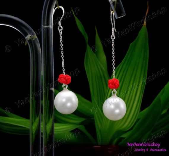 This pair of earrings each has a round cream colored Shell Pearl, measuring 14 mm. The Red Knots can be removed easily, giving the earrings a different look. All of the metal parts are made of nickel free 925 Sterling Silver and the overall drop of the earrings is approximately 2 inches (5 cm).