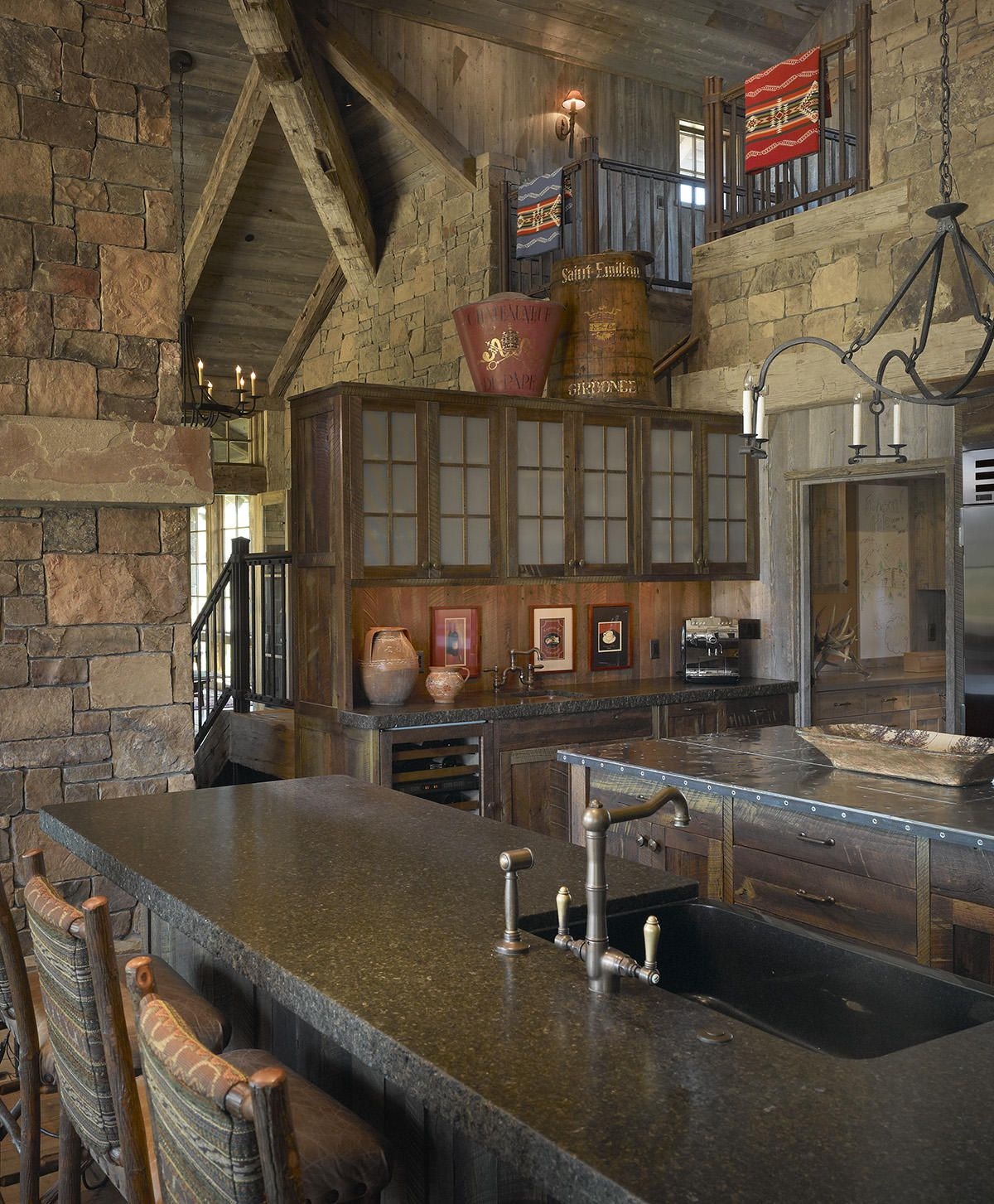 Amazing stone work and other details in this log home kitchen make