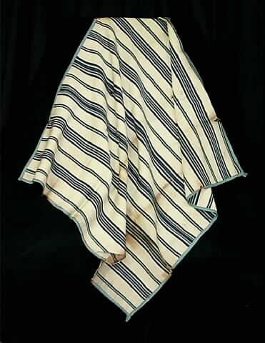 Blanket, baby's, off-white and blue striped wool, hand-woven, c. 1775 Hand-woven fine off-white wool yarn; striped pattern with alternating thick and thin bars of different shades of blue intermingled with off-white; entire piece is bound in a medium blue silk tape, hand-sewn.