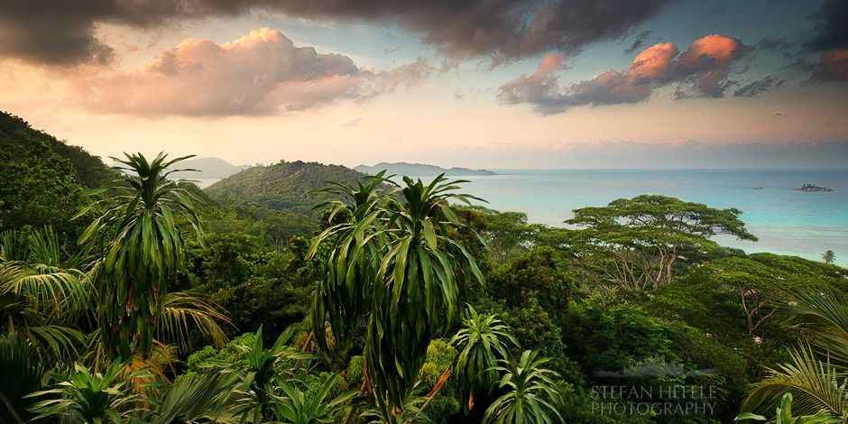 On top of the paradise - ON TOP OF THE PARADISE - Seychelles 2013  You would never believe how I managed to get to this amazing jungle setting. A strenuous climb on a high Takamaka tree in the middle of the dense rainforest was necessary to reach this point of view... Now seriously :-). That was our view from the terrace of our stilt-hut at the Mango Lodge. Nevertheless I was sweating, because it was always very hot and humid. Enjoy the view of paradise.  https://www.facebook.com/StefanH...