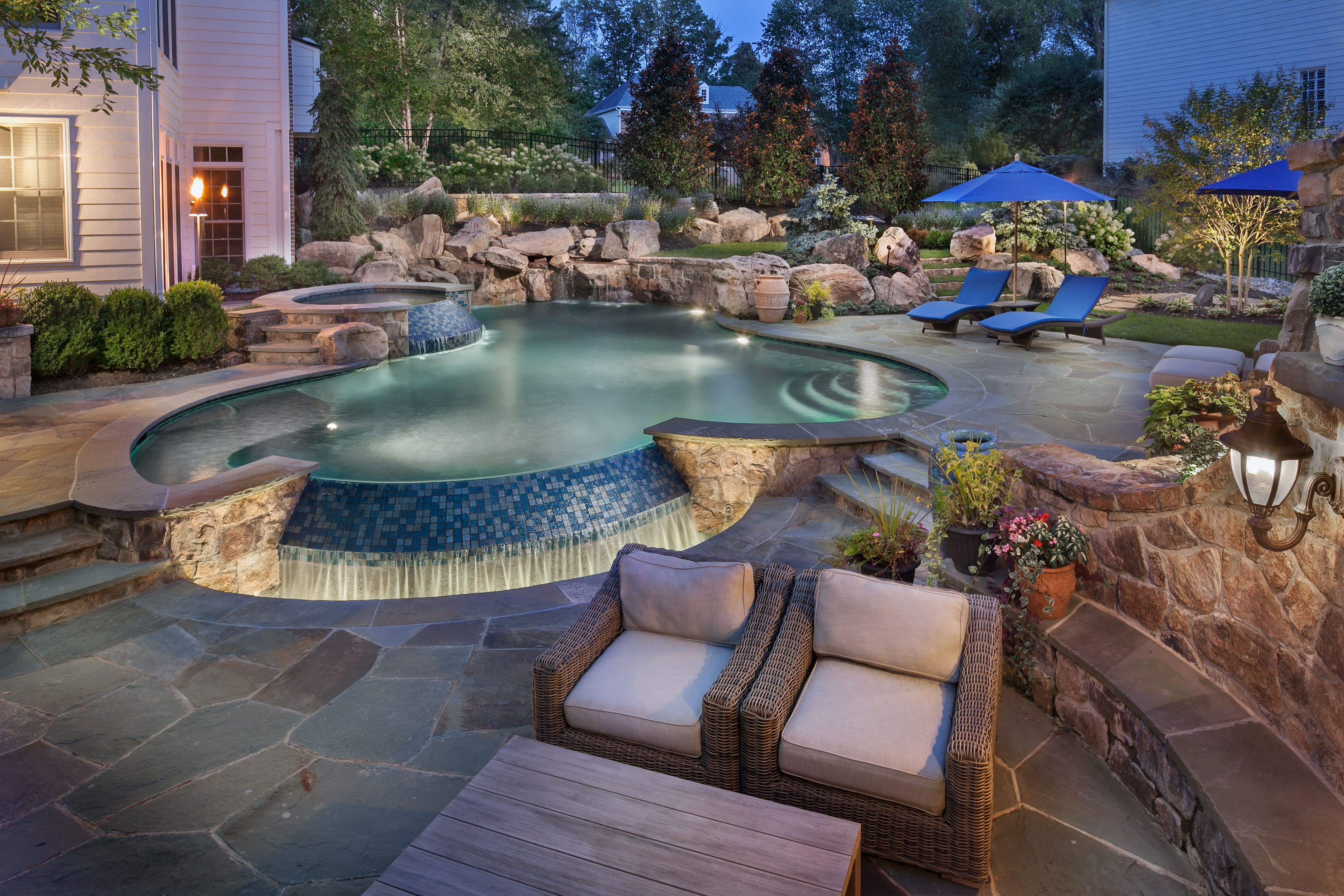 Infinity Edge Pool With Boulder Waterfall And Spa Pools