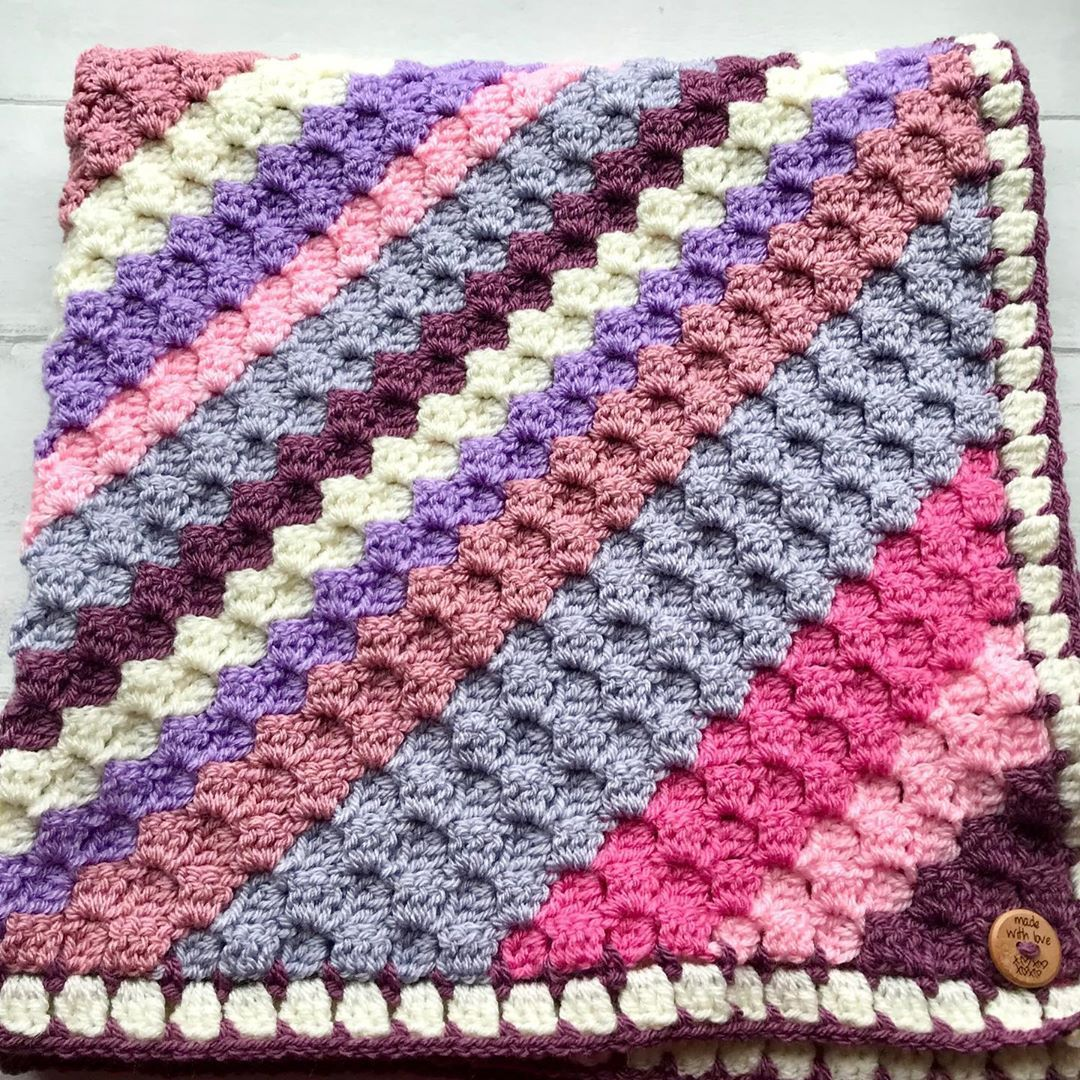 Latest little c2c baby blanket pretty pinks and purples ????. Emmm what to make next ? . ##blanket  #crochetlove  #craftastheraphy  #amigurumicrochets  #makersgonnamake  #crochetersofig  #crochethooks  #crochetlover  #crochetdesign  #crocheting  #makeanddocrew  #moderncrochet  #crocheterapia  #crochetando  #crochettoys  #crochetastherapy  #crochetaddicte #c2cbabyblanket