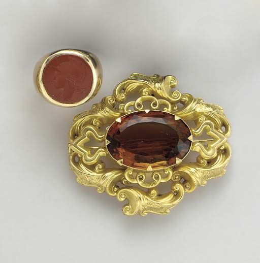 An antique citrine and plated brooch, circa 1865 and a 14k gold and carnelian intaglio ring