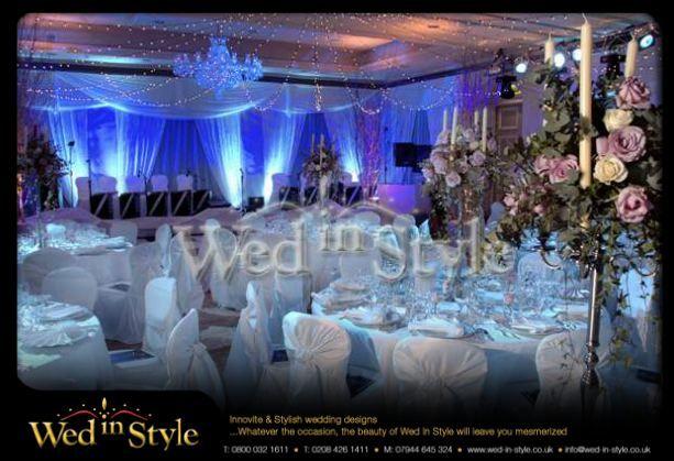 www.wed-in-style.co.uk  I like the flowers / candelabra arrangment