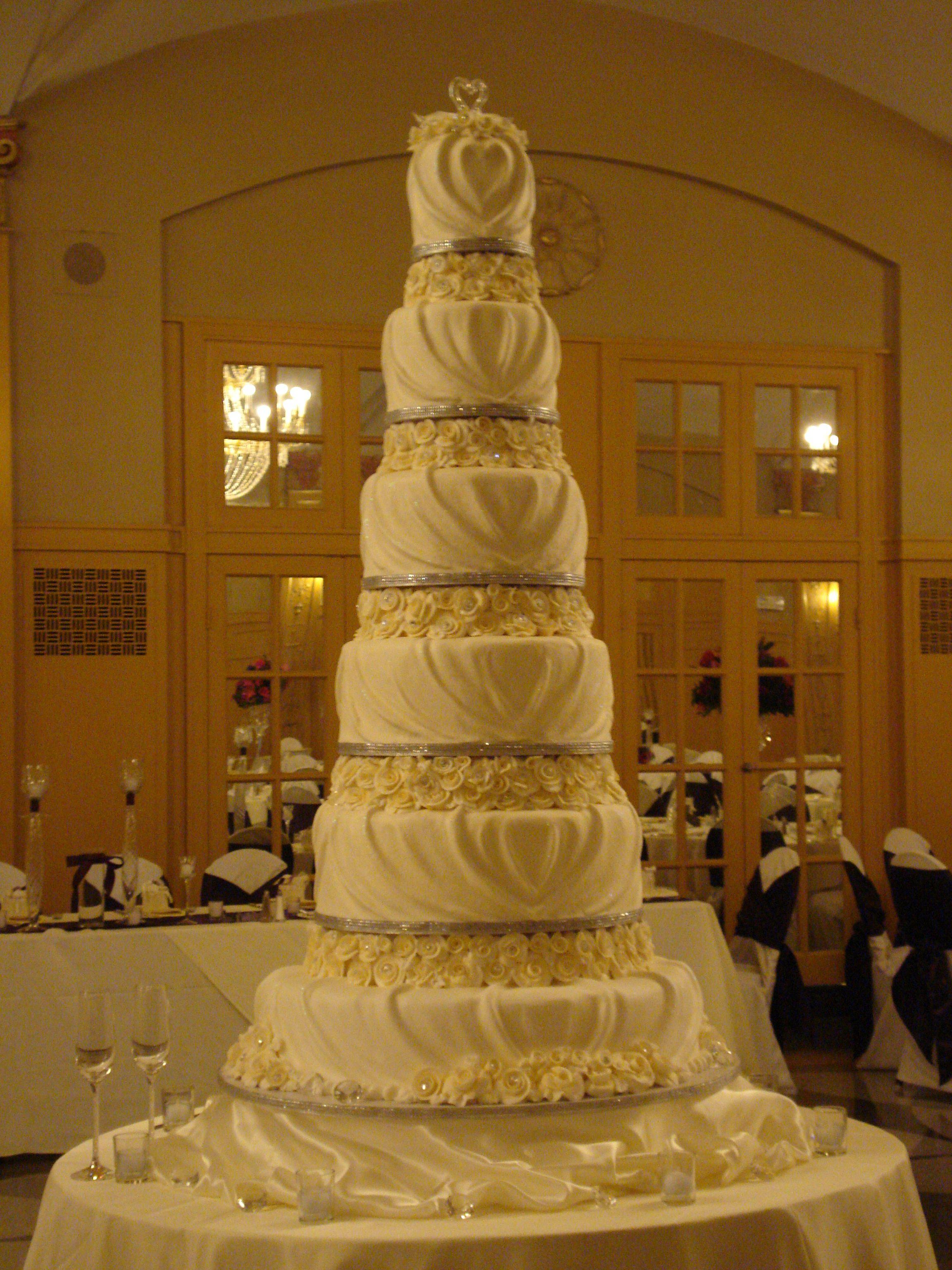 Buttercream draped six tier wedding cake - All buttercream icing ...
