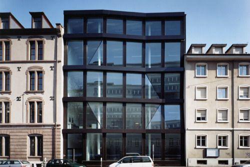 adjacent: a room, building, piece of land,... that is ... Adjacent Buildings