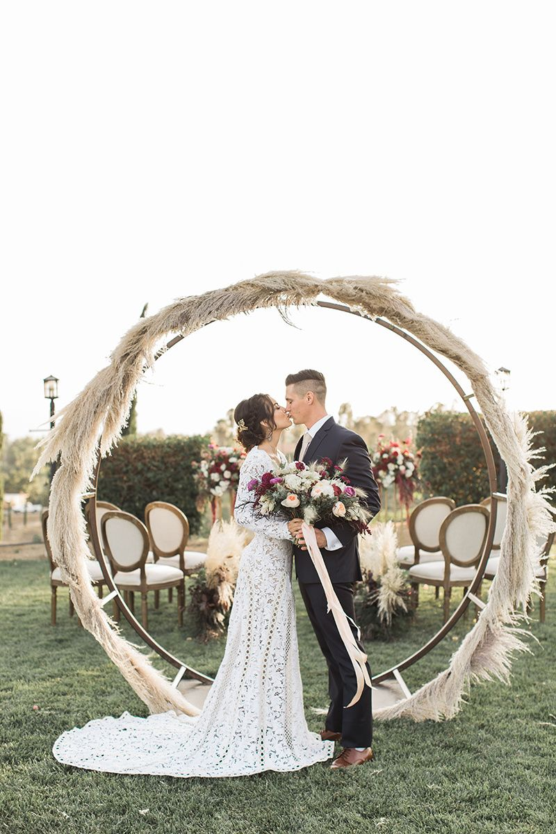 Wine country wedding inspiration with a pampas grass arch country