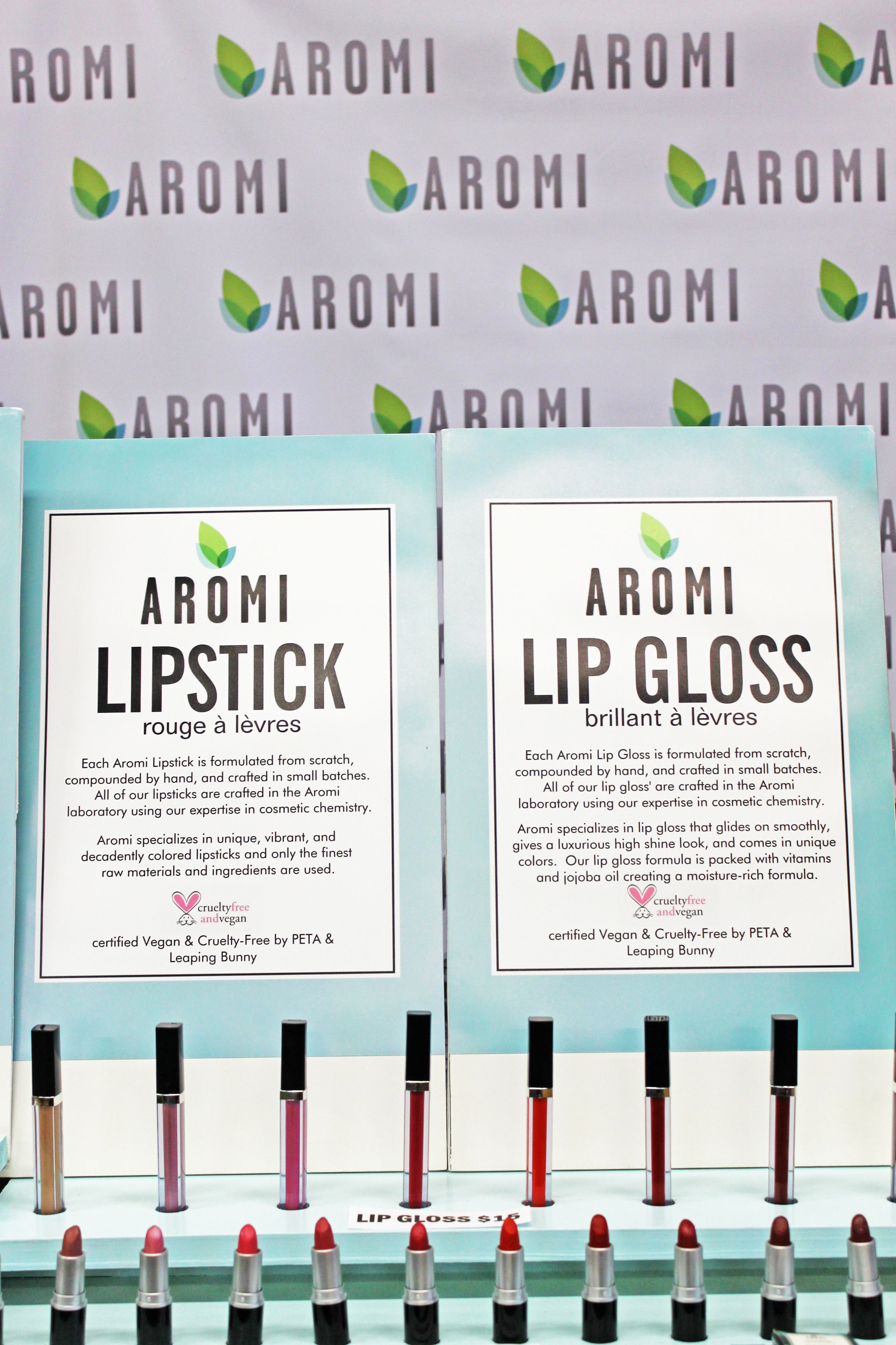 Aromi lip gloss and lipstick at the Chicago Renegade Fair.  Aromi cosmetics are handcrafted in small batches, vegan, cruelty-free, and come in a beautiful cosmetic box.  Certified by PETA and Leaping Bunny