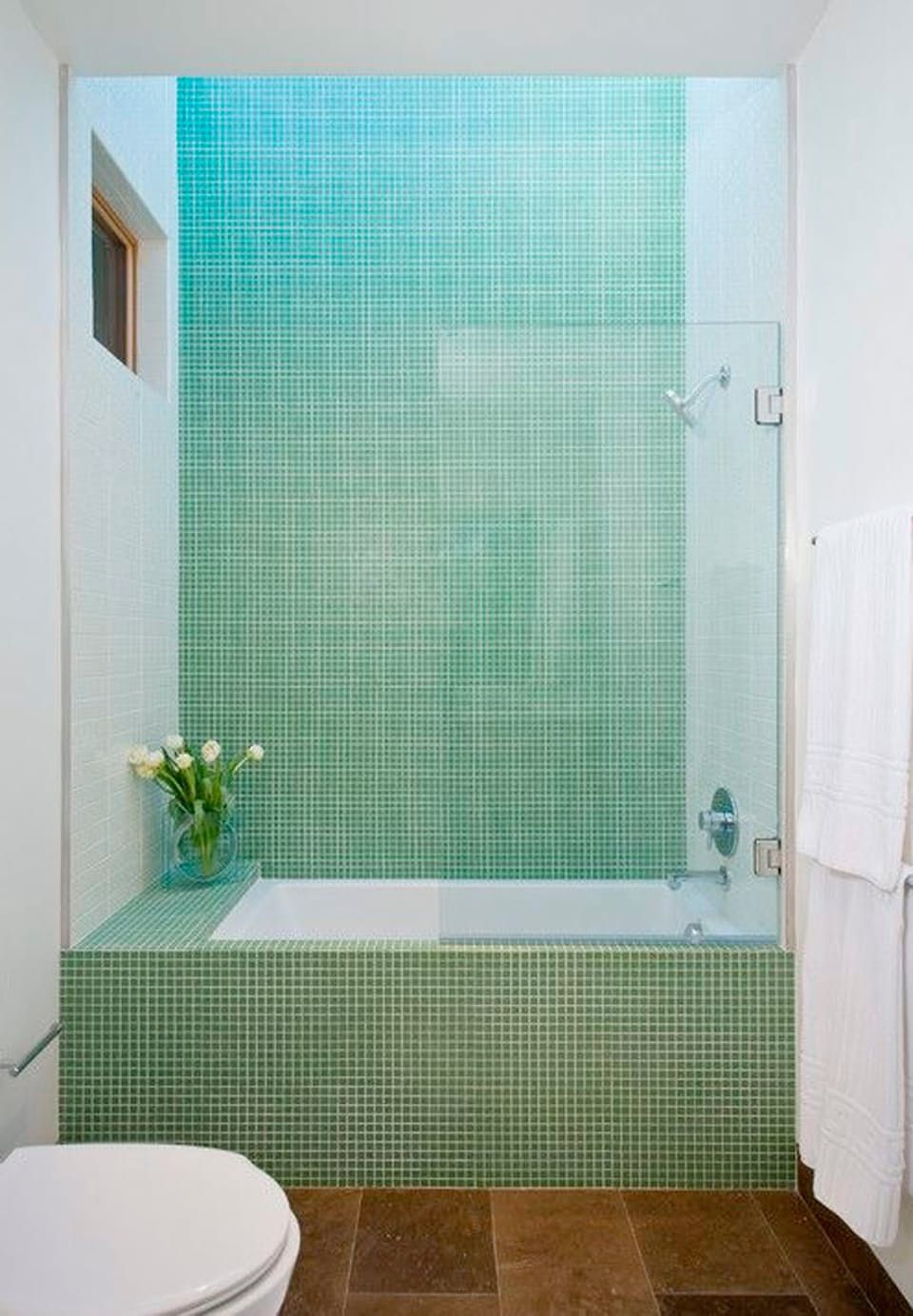 Simple and beautiful blue-green mosaic on the bathtub and wall, in ...