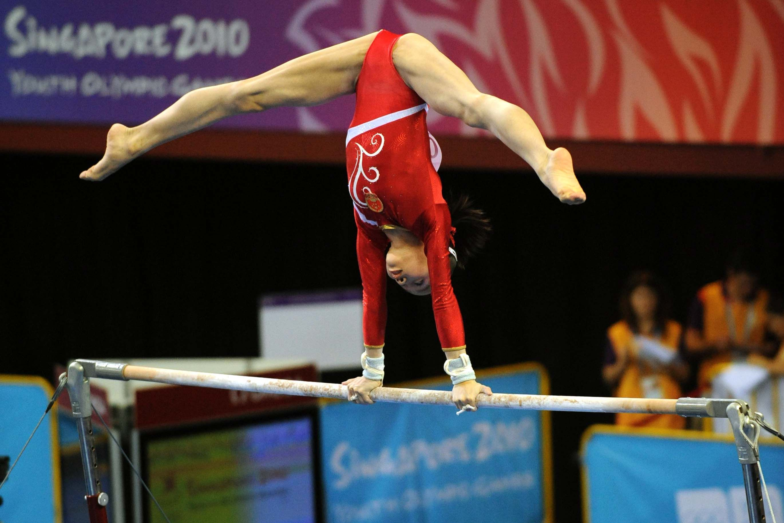 Tan Sixin on uneven bars at the 2010 Youth Olympic Games