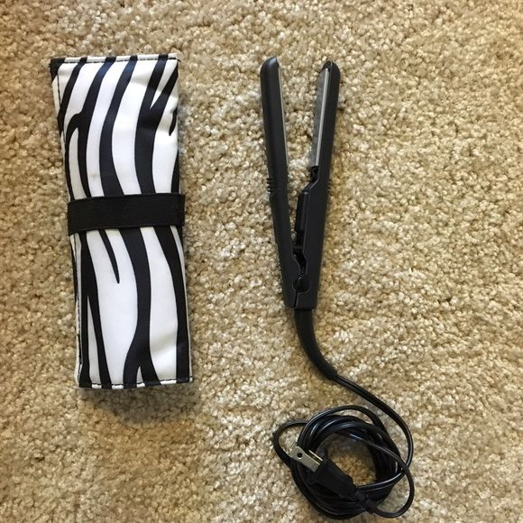 Conair Mini Straightener Never used, comes with zebra case. Last photo shows the size of the straightener colored to an iPhone 5s Accessories Hair Accessories
