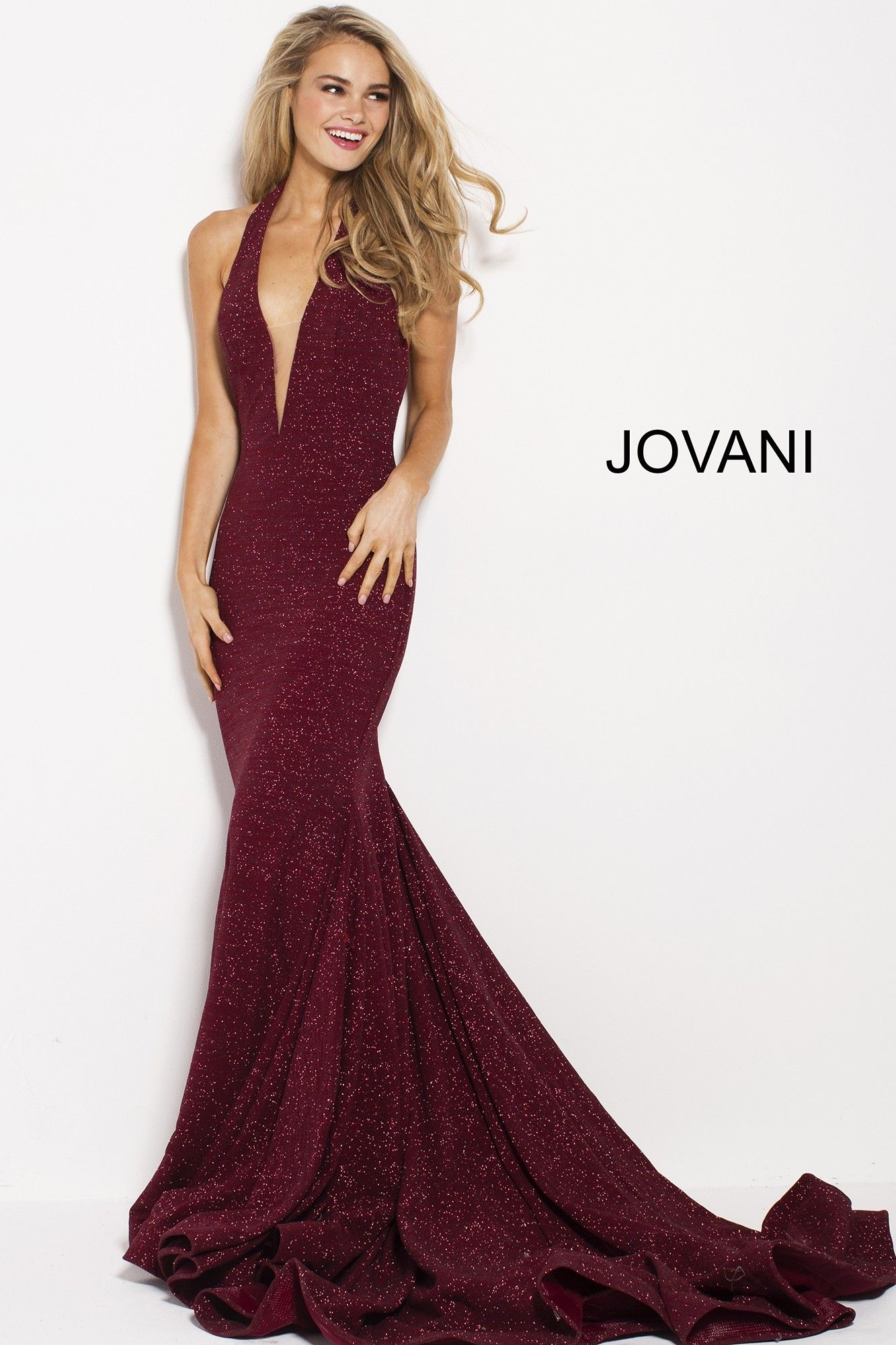 add41dbac3f5 You can't deny the glamour of Jovani 55414. This dramatic mermaid gown  shimmers with glitter, from start to finish. The halter bodice has a deep  plunge ...