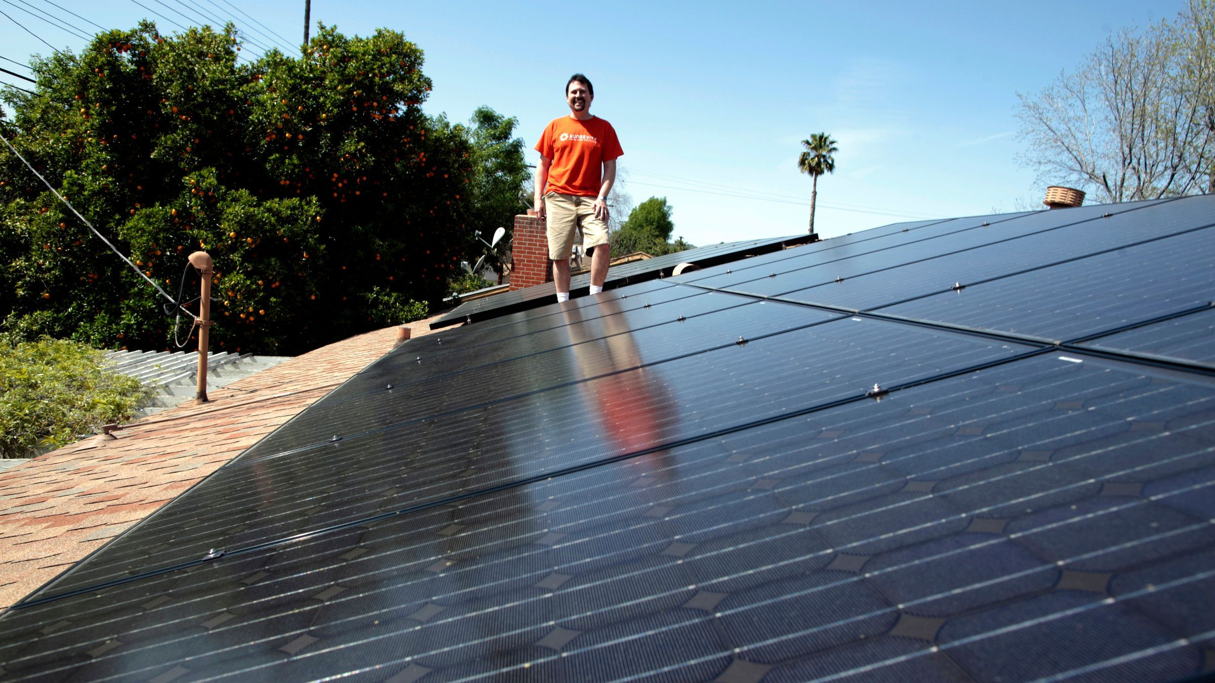 The Real Reason Elon Musk Is Bringing Tesla And Solar City Together Solar Solar City Solar Panels For Home