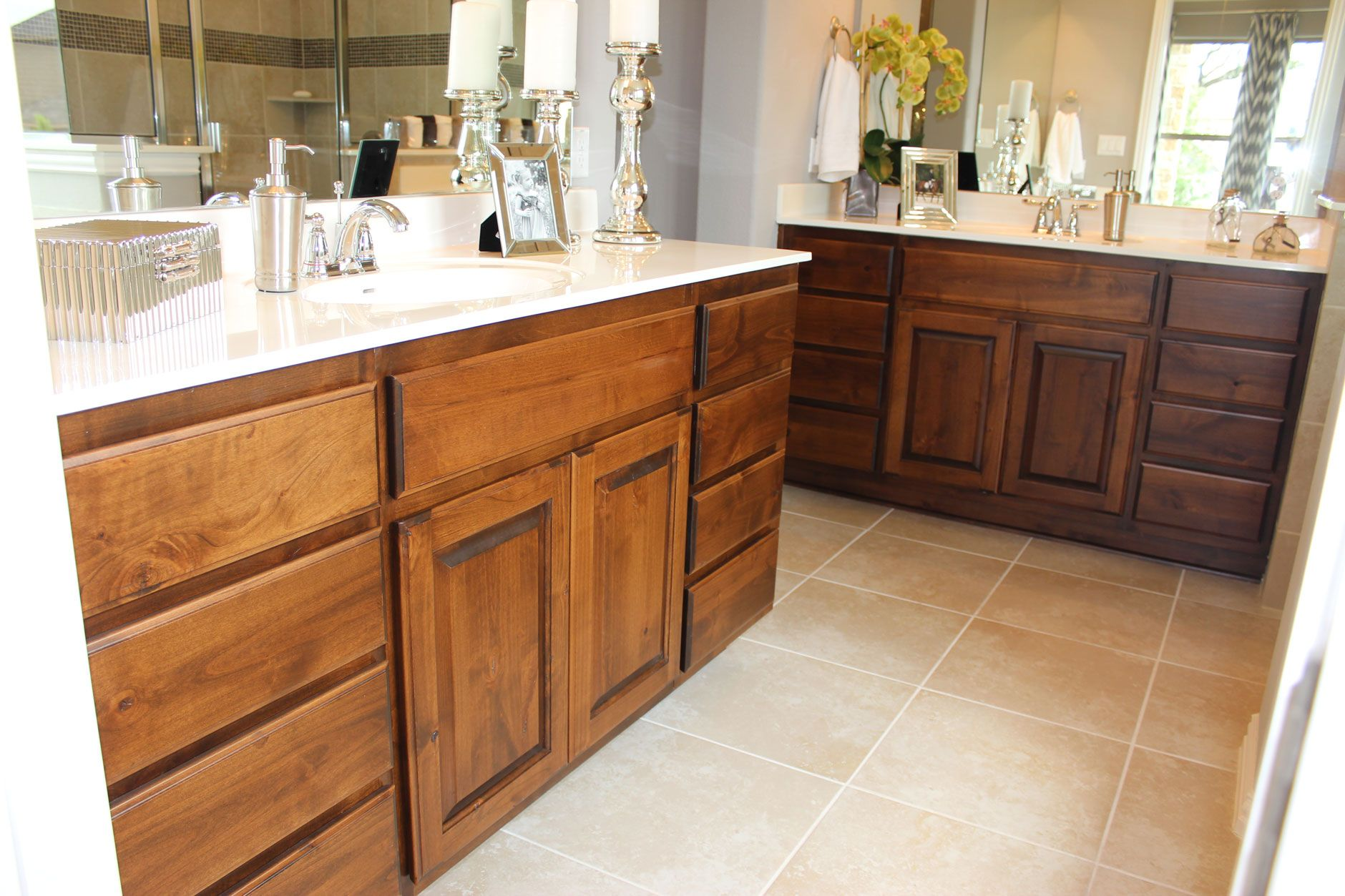 L Shaped Master Bath With Knotty Alder Cabinets And Light Counter Tops With  2 Separate Vanities