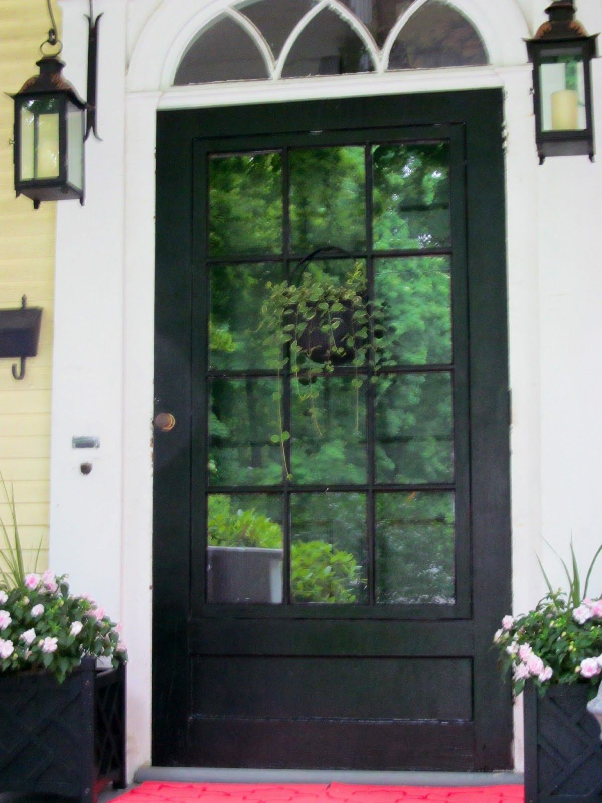 Stained front door with white trim know i 39 ll get to the for Black wooden front door