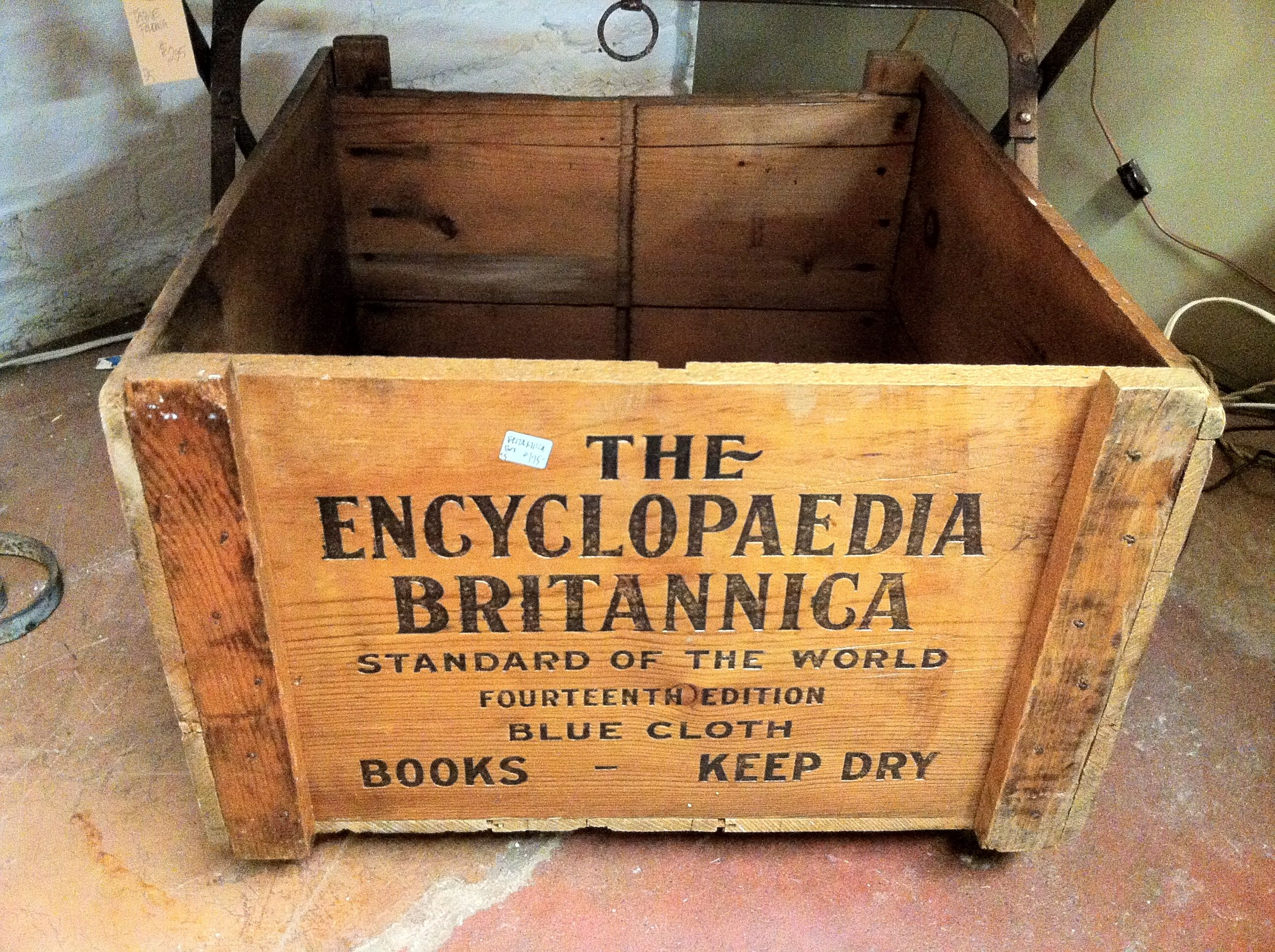 antique wood crates stamped with company name Google