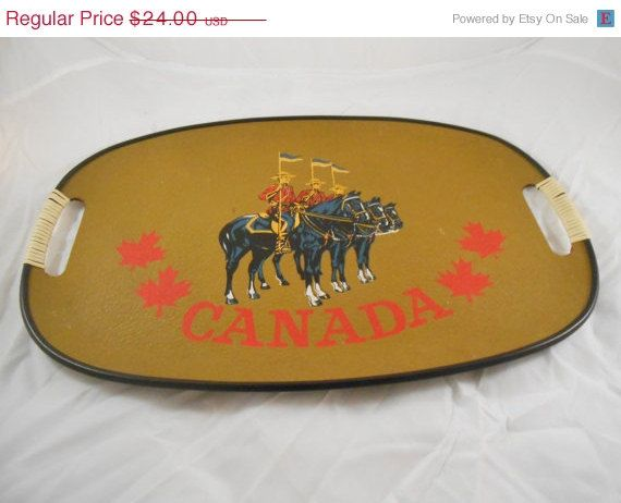 Vintage hand painted souvenir tray from Canada. Measures 11.5 x 17.5 inches. Good vintage condition.