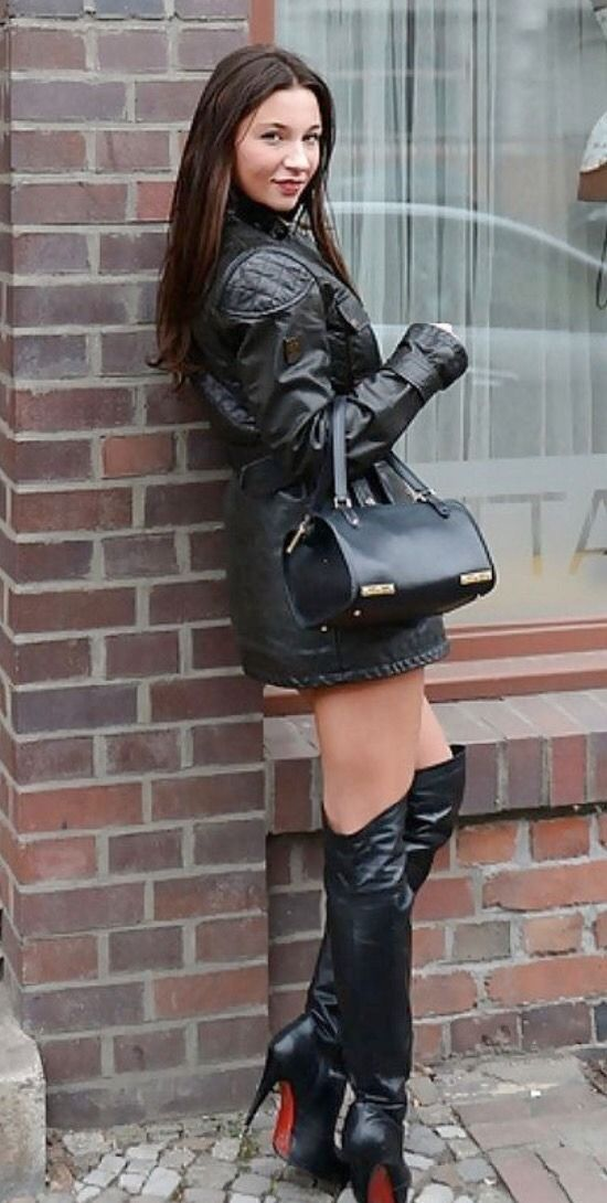Photo of Women's leather mini skirt and long leather boots