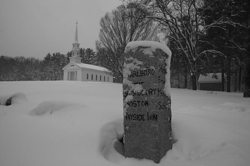 Heavy snow obscures the writing on the post outside the Martha Mary Chapel