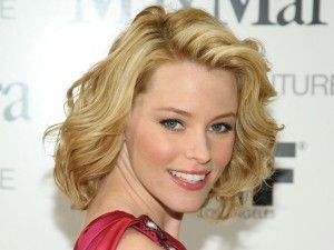 wonder if I could pull off this hairstyle.  no money for haircut = growing it out.  My hair is naturally curly like this.