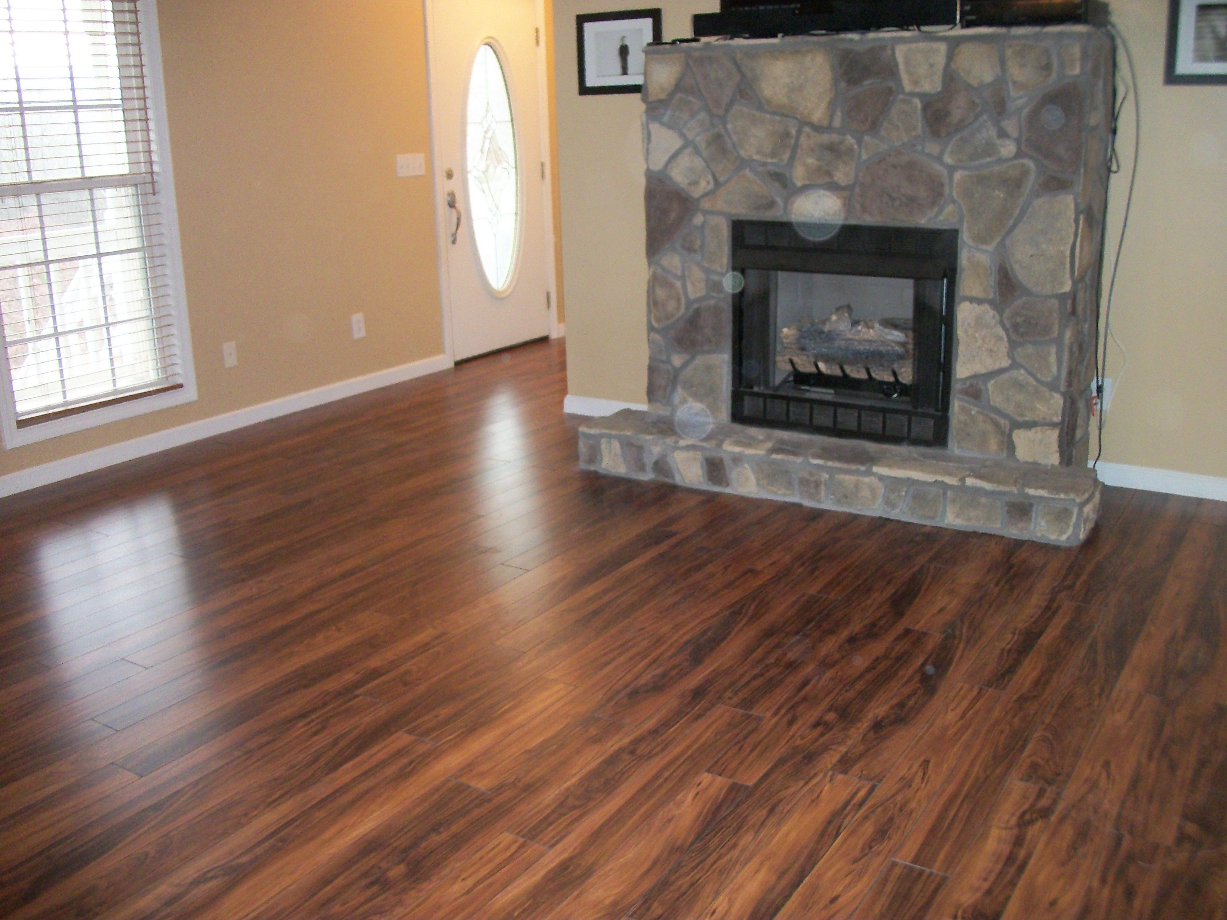 New laminate flooring looks great with the fireplace