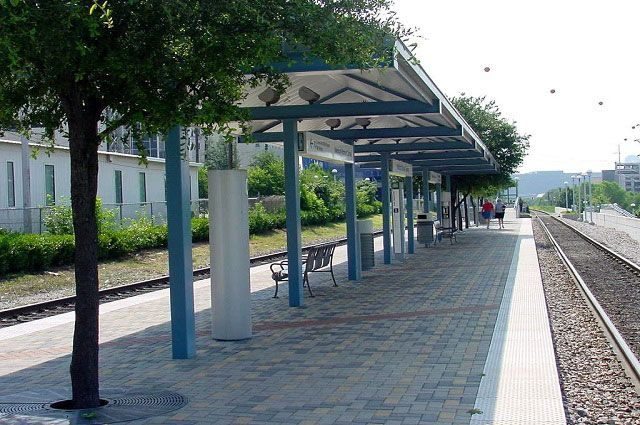The  Medical/Market Center Station is a Trinity Railway Express commuter rail station situated at 1419 Motor Street along the Stemmons Corridor in north Dallas.