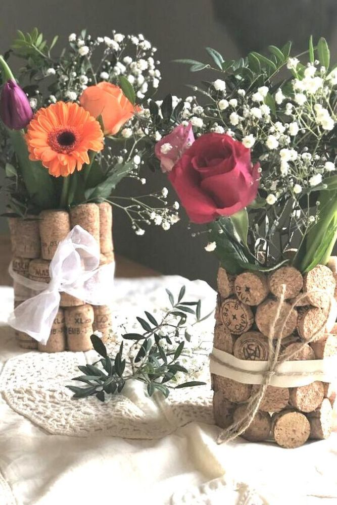 If you're looking for cheap table decorations for parties or wedding check out this cork craft idea. All you need is a wine glass corks and flowers and for this quick and easy decor project. #diy #centerpiece #wedding #cork #azerbaijanfood #liberianfood #surinamefood #blinchikirecipe #sisigrecipe #ugandanfood #slumgullionrecipe #sudanesefood #somalifood #somalianfood
