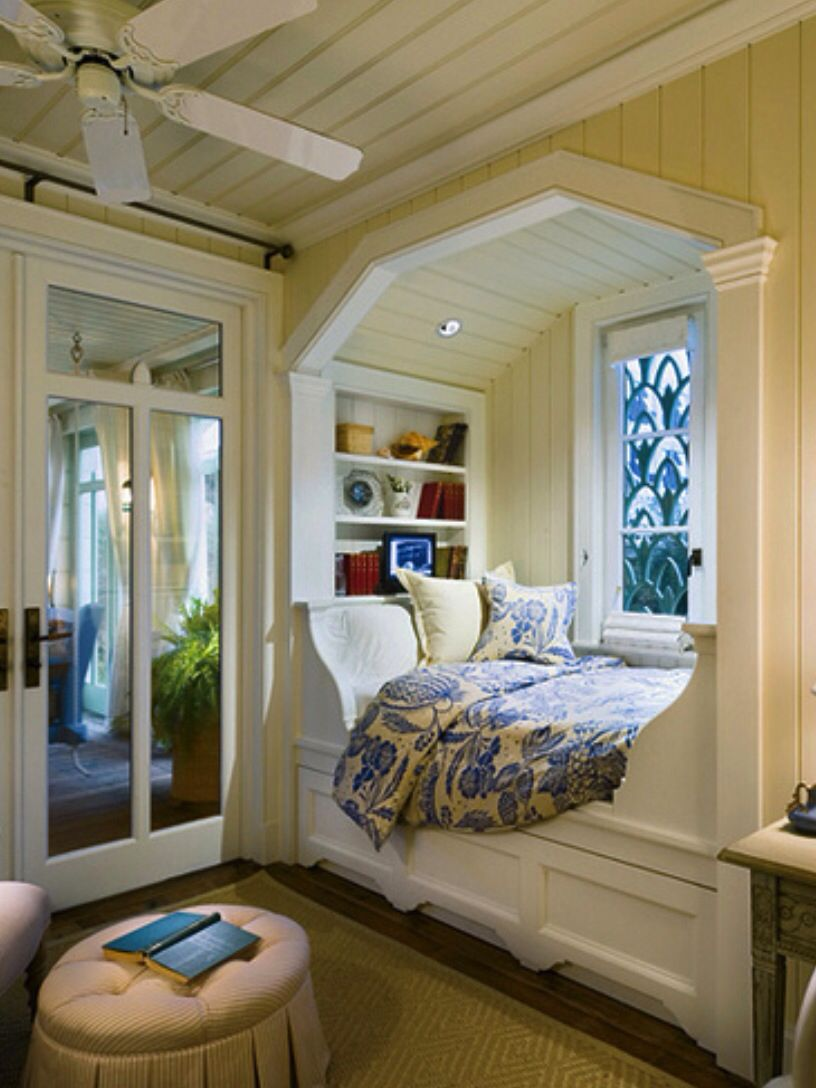 Window above bed  a beautiful space for reading sleeping or just reflecting  books