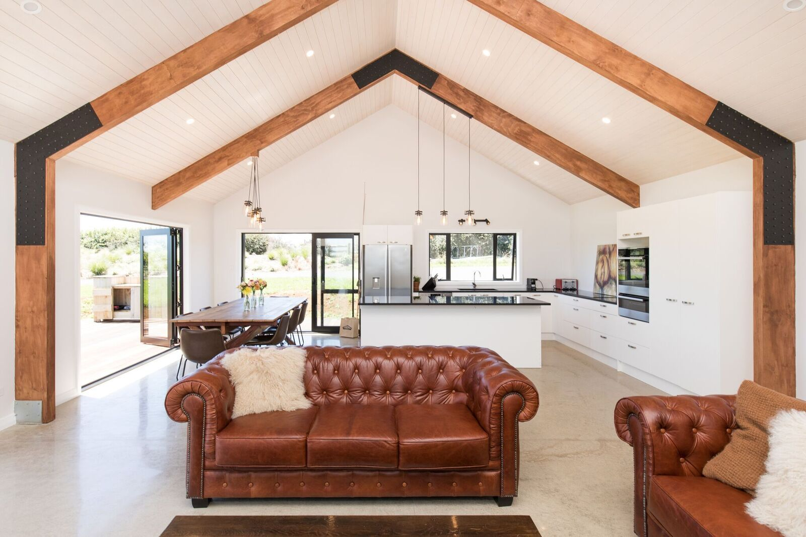 Cathedral ceilings create a stunning effect in the open ...
