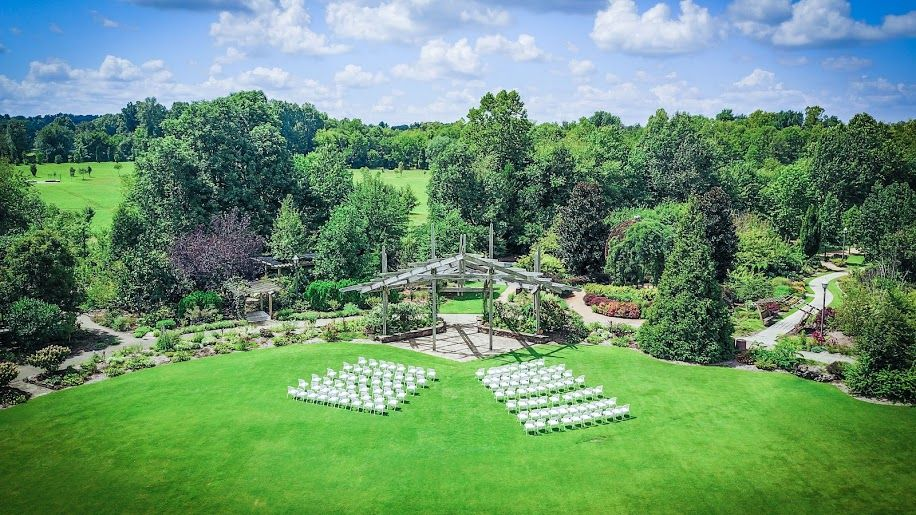 Chairs set up for a wedding ceremony on the Great Lawn at the Botanical  Garden of the Ozarks | Fayetteville, AR Power Tribe … | Botanical gardens,  Botanical, Ozarks