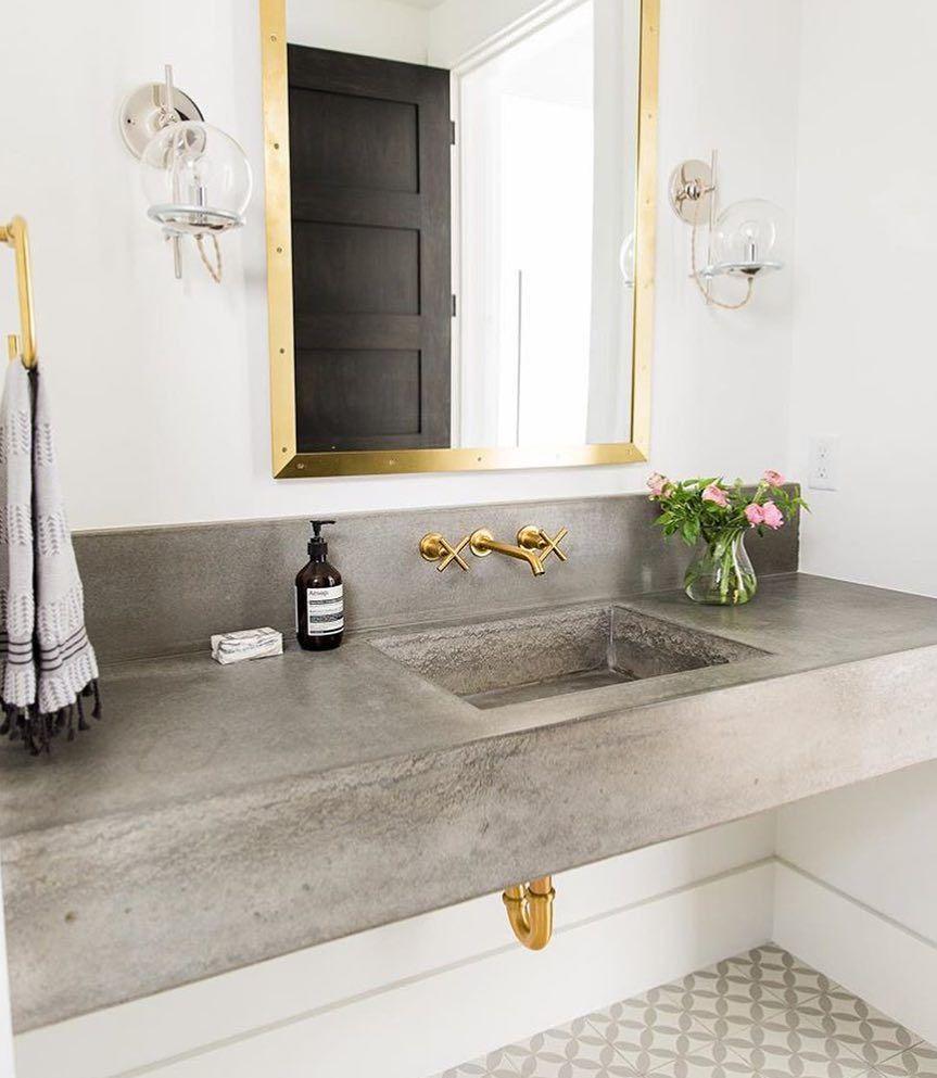 concrete @studiomcgee #interiordesign #bathdesign #brass #concrete #cement #mosaic #rivets #modern #design #designinspo #dailyinspiration #inspiration #followme #whateverislovely #letsmakewaves #luxury #lighting #lightingdesign by waves_of_design