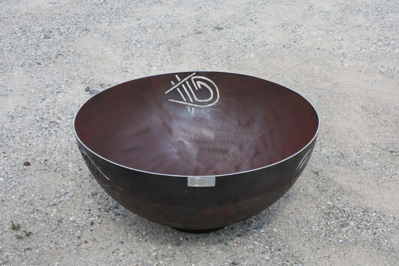 Alex Townsend was a passionate artist and musician studying graphic design at the Savannah College of Art and Design when he tragically passed away at the age of 21. As a remembrance, the family commissioned me to create a firebowl incorporating Alex's signature tag. The tag is cut into three sides of the bowl, which sits as the centerpiece of a round stone patio in a memorial garden. One hopes that the firebowl can be a gathering place for friends and family to remember Alex.
