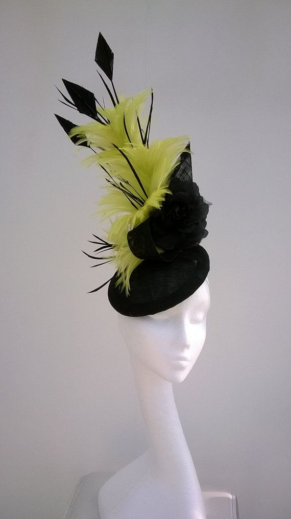 Dramatic sinamay fascinator in black with striking lime yellow feathers  which entwine the three arrow head feathers. Soft black roses soften 3bbe016326a