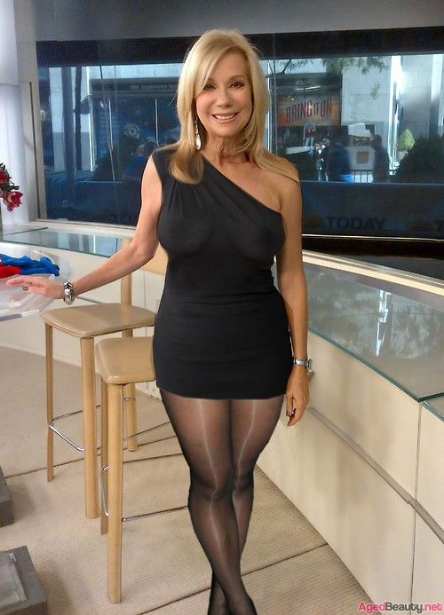 Amazing milf in black dress