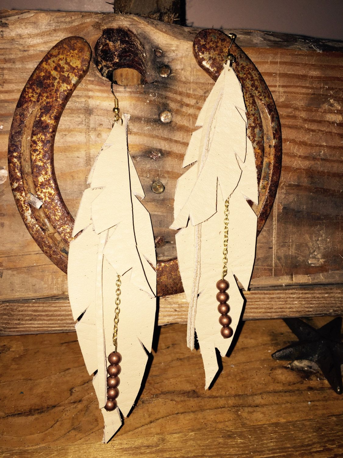 Leather feather beaded earrings by 2BlondesCrafting on Etsy