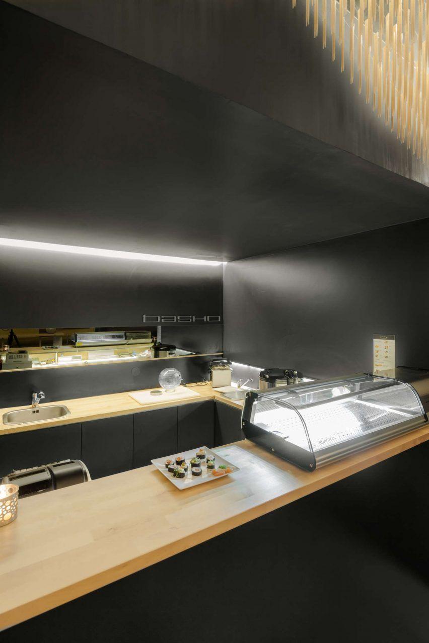 Paulo Merlini suspends chopsticks from ceiling of minimal sushi bar
