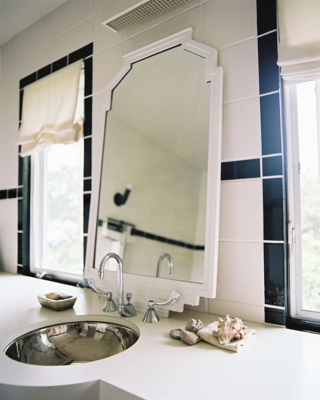 Shells and vintage mirror in the bathroom - Vicente Wolf at Home in Montauk, New York