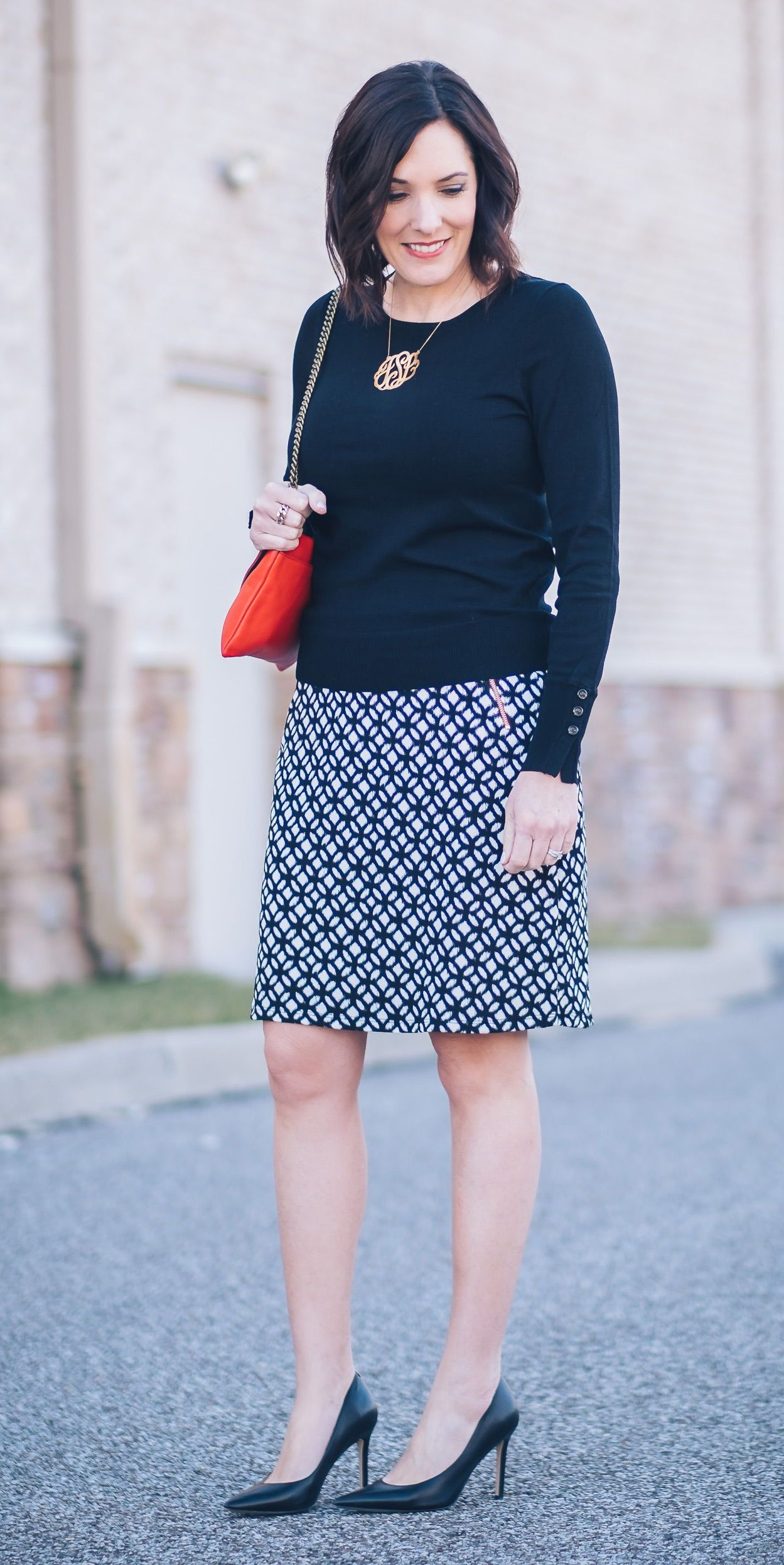 5ca15122c4 Jo-Lynne Shane wearing an early spring work wear look with LE LIS Maura Zip  Pocket Detail Skirt from Stitch Fix with black Sam Edelman Hazel pumps and  a red ...
