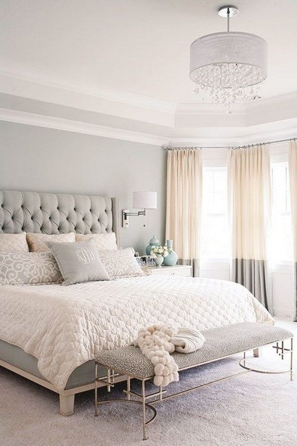 Neutral bedroom with tall tufted upholstered gray