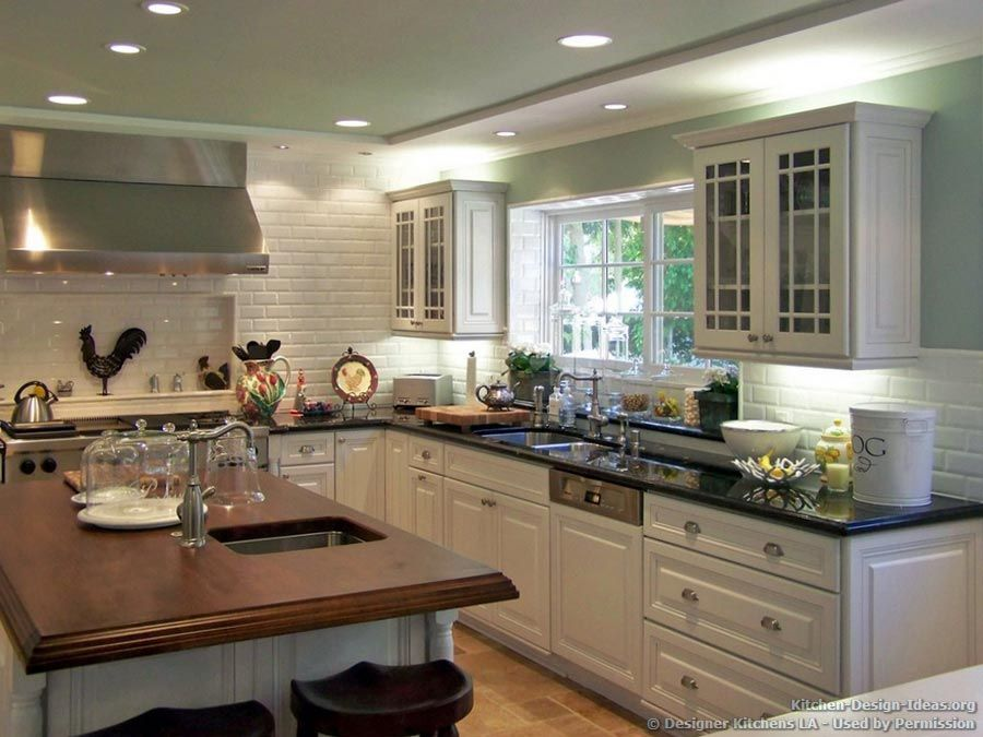 deluxe country kitchen with green walls, wood island countertop