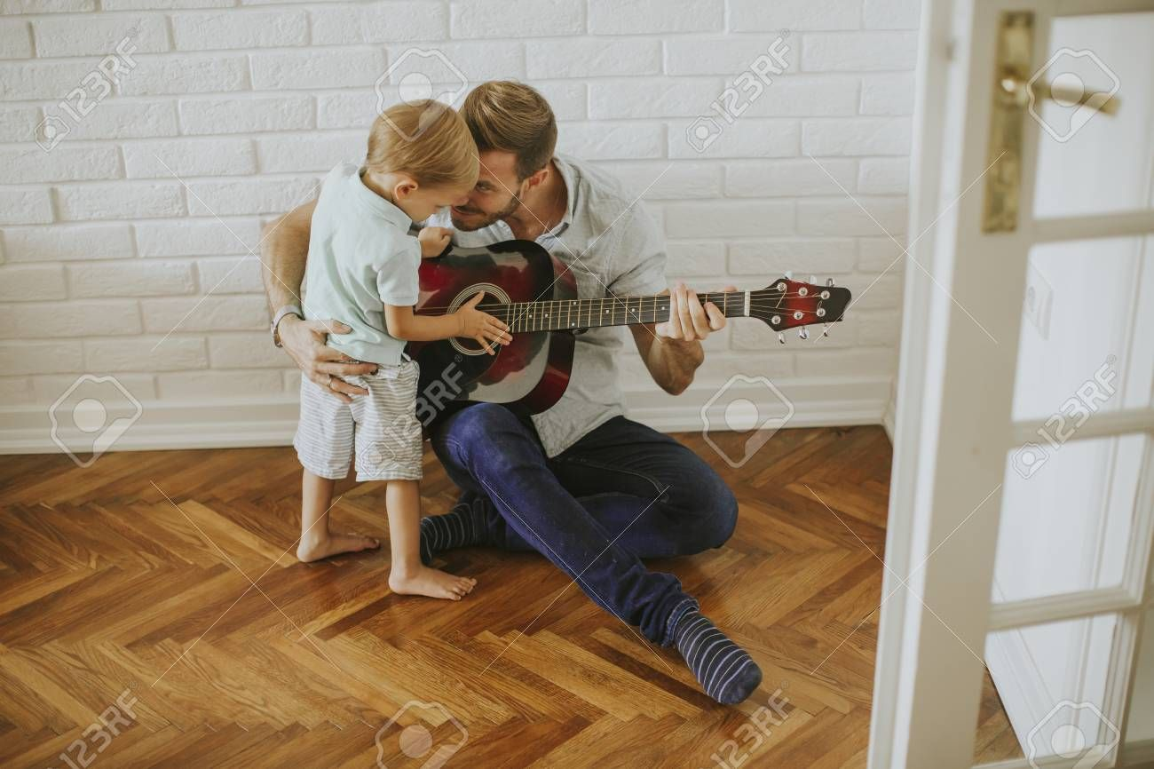 Father And Little Son With Guitar At Home Affiliate