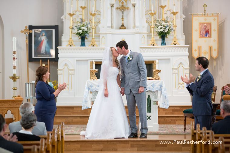 first kiss at ste anne church mackinac island photo at wedding by Paul Retherford #mackinacislandwedding #steannechurch #mackinac #destinationwedding #church #weddingvenue #mackinacisland #puremichigan